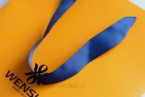 custom luxury Embossed paper shopping bags add grosgrain ribbon
