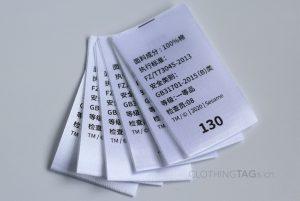 White printed satin fabric care label   center fold 683