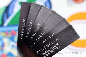 Printed black fabric main label | flat fuse cut 707