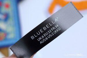 Printed black fabric main label | flat fuse cut 708