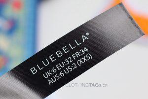 Printed black fabric main label | flat fuse cut 709