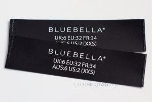 Printed black fabric main label | flat fuse cut 710