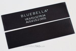 Printed black fabric main label | flat fuse cut 711